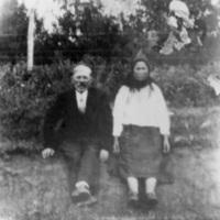 Baba and grandpa sitting on a bank